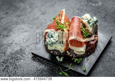 Antipasto Platter With Jamon, Prosciutto, Blue Cheese, Appetizers. Meat Snacks For Red Wine. Appetiz