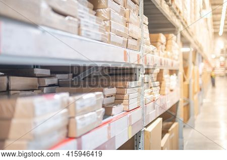 Warehouse With Cardboard Boxes Inside On Pallets Racks Prepare For Customer For Choose And Shopping