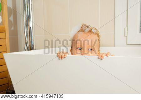 Little Toddler Boy Play Hide And Seek In A Bathtub