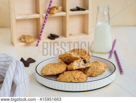Homemade Oatmeal Cookies With Banana And Chocolate On A White Plate On A Light Concrete Background.