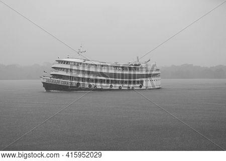 Boat On Amazon River With Rain. Amazonas. Brazil