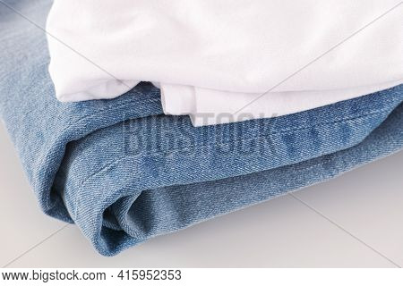 Blue Jeans And White Shirt. Close Up.