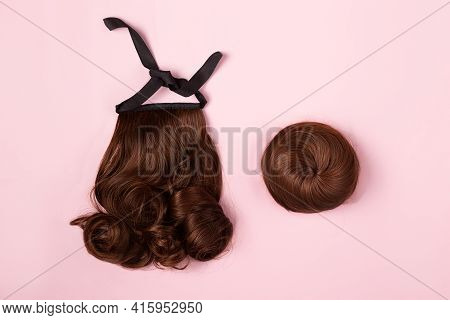 A Brown Hairpieces On The Pink Background. A Ponytail And A Bun Chignon, Hair Extension, Quick Easy