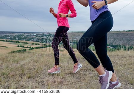 Two Woman Running The Run On The Field. Healthy Young Pretty Woman Jogging, Doing Sport Outdoor, Fre