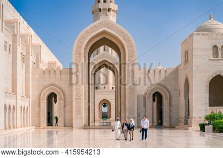 Muscat,oman - 04.04.2018: People In The Courtyard Of Sultan Qaboos Grand Mosque.