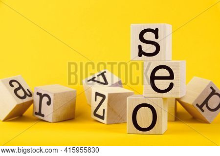 Seo, Search Engine Optimization, Text Wooden Cube Blocks On Yellow Background. Idea, Vision, Strateg