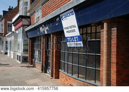 TENTERDEN, ENGLAND - APRIL 4, 2021: A vacant former branch of fashion chain Monsoon. Some 35 stores were closed after being bought out of administration in June 2020.