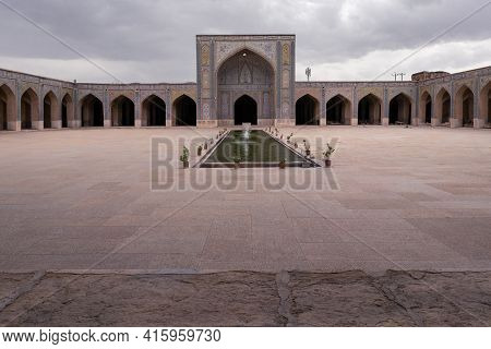 Shiraz,iran-04.18.2019: Courtyard Of Vakil Mosque In Shiraz, Iran. Archway, Stone Floor And Water Fo