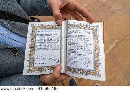 Shiraz, Iran - 04.14.2019: Man Holding Open Book Of Hafez Shirazi, Famous Persian Poet. Shiraz, Pers