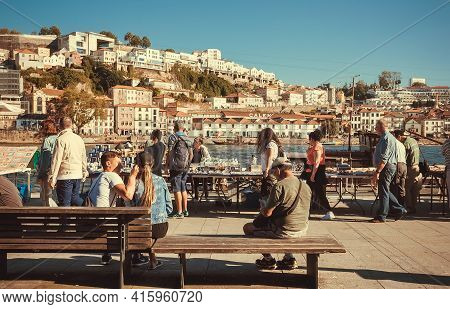Porto, Portugal: Many People Walking Around Historical Riverside Of Douro River, Sunny Day On 19 May