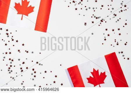 Happy Canada Day Concept. National Flags Of Canada And Confetti On White Background. Canada Independ