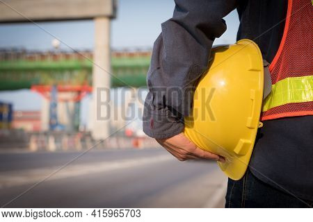 View From The Back, Yellow Helmet With An Engineer Who Built An Elevated Road