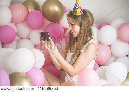 Lovely Lady In Pajama Making Selfie In Her Bedroom Using Phone. Happy Birthday. Girl Is  Lying On Be
