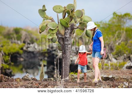 Mother and daughter hiking at Los Tuneles, Galapagos islands, Ecuador