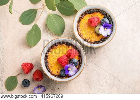 Creme Brulee. French Vanilla Cream Dessert With Caramelised Sugar And Berries, Selective Focus.