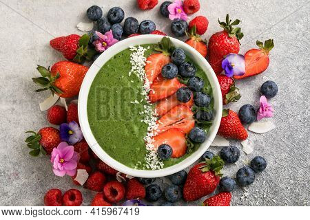 Matcha Green Tea Breakfast Superfoods Smoothies Bowl Topped With Strawberries, Blueberries, Coconut