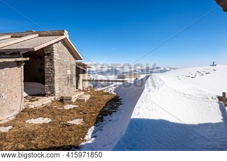 Typical Old Stone Cow Shed On Lessinia Plateau (altopiano Della Lessinia) In Winter With Snow Near T