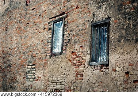 Two Windows In Red Brick Wall Building In Weird Diagonal Placement
