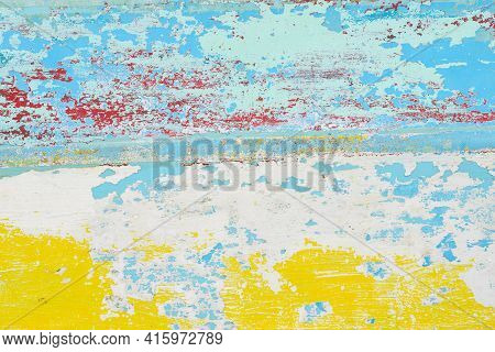 Abstract Paint Background With Random Patterns Of Layers Of Aged And Weathered Paint On A Wood Surfa