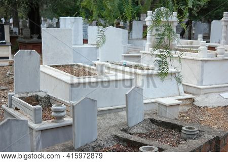 Graves And Tombstones At Muslim Cemetery. Graves Background.