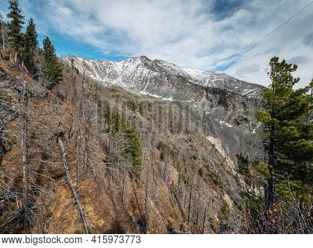 Eastern Sayans In Autumn. Snow-capped Peaks Of Tunkinskiye Goltsy Ridge.