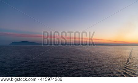 A Stunning Blue And Orange Sunset Sky In The Middle Of Adriatic Sea, With An Island At The Distance.