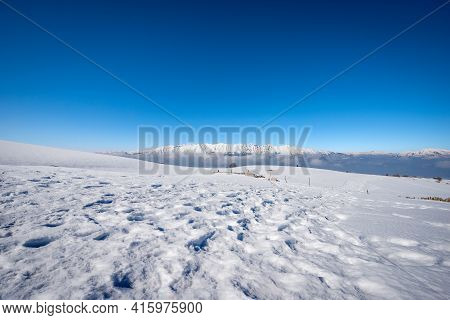 Mountain Range Of Monte Baldo And Adamello In Winter With Snow,  View From The Lessinia Plateau (alt