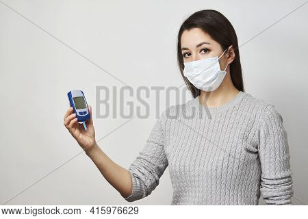 Woman With Blood Glucose Meter, Close-up