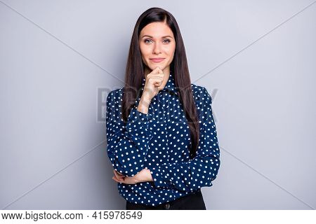 Photo Of Optimistic Brunette Girl Fist Chin Wear Blue Blouse Isolated On Grey Color Background