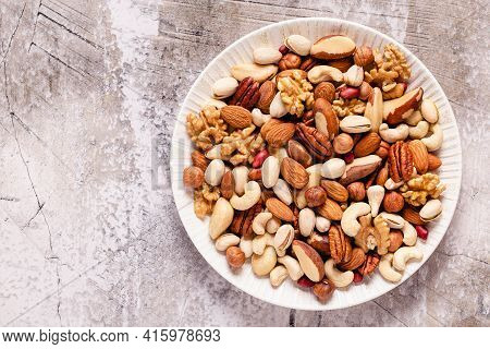 Various Nuts On A Plate, Top View.