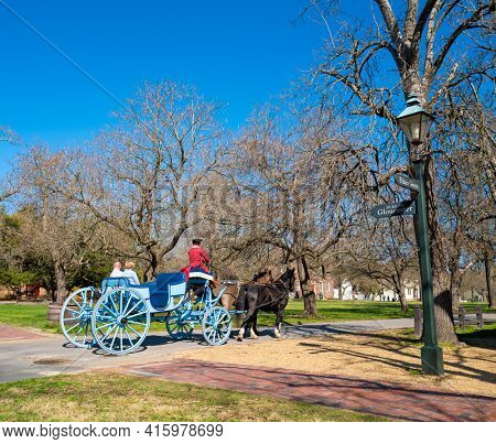 Williamsburg, Virginia, USA: 29th March 2021; House and carriage in the historic town of Williamsburg.