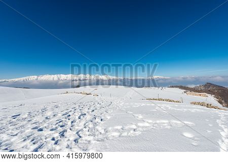 Mountain Range Of The Monte Baldo, Adamello And Brenta Dolomites In Winter With Snow, View From The
