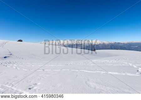 Mountain Range Of Monte Baldo And Adamello In Winter With Snow, Seen From The Lessinia Plateau (alto