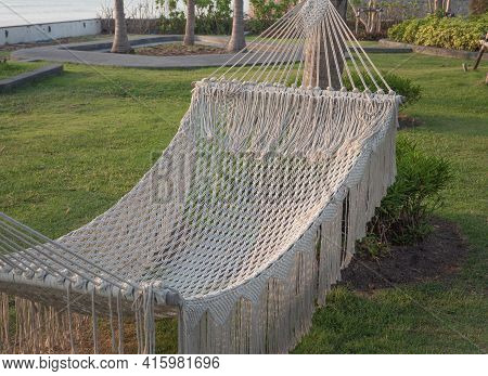 Tourist Hammock For Relaxing On The Resort. Hammock For Outdoor Holiday Recreation.