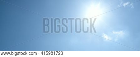 Sun And Direct Sunlight On A Clear Blue Sky With Copy Space