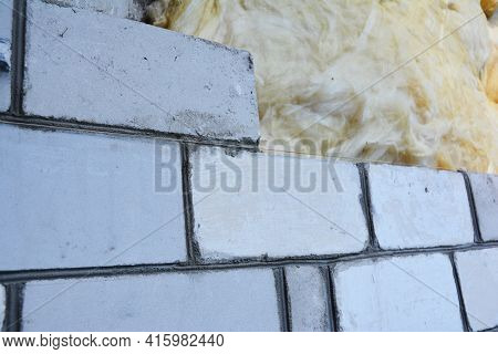 Mineral Wool, Glass Wool House Exterior Wall Insulation With Silicate Bricks Bricklaying. A Close-up