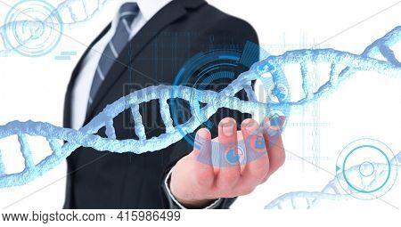 Dna structure and digital interface over mid section of business man with cupped hand. global business and medical research technology concept