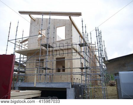 Prefabricated House In Full Construction Where Scaffolding And Construction Materials Are Observed