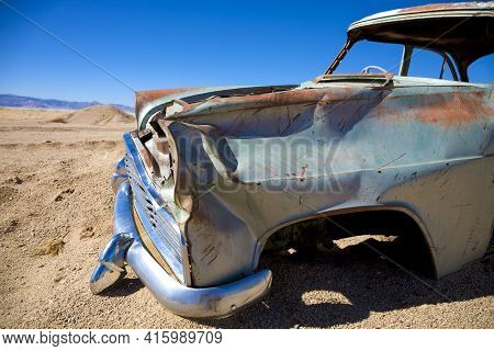 Solitaire, Namibia, January 15: Old Colored Vintage Wreck Car Abandonned In A Junkyard With Clear Bl