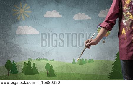 Close Up Artist Hand Holding Paintbrush. Painter In Shirt Standing On Background Colorful Picture. S
