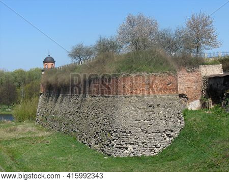 Fortified Wall With A Watchtower On The Bastion Of Medieval Castle At Dubno Town, Rivne Region, Ukra