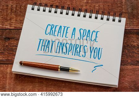 create a space that inspires you - inspirational writing in a spiral notebook with a stylish pen against weathered barn wood table, business and working from home concept