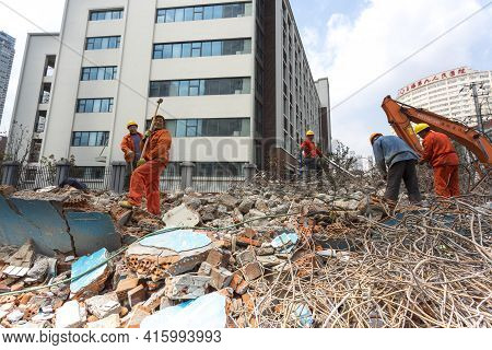 China, Shanghai, April 6: Unidentified Group Of Men At Work Demolishing A Building In Shanghai Cente