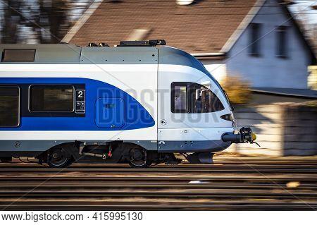 Untitled Passenger Train Arrival At Railway Train Station. Platform Track Front View. Public Transpo