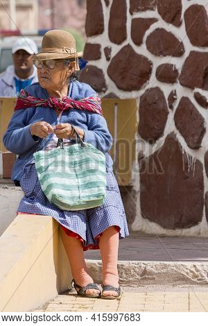 Tupiza, Bolivia, December 29: Unidentified Senior Woman Sitting On A Bench During The Saturday Marke