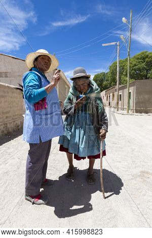 Rosario, Bolivia, Jan 1: Old Bolivian Woman Helping A Senior To Walk With A Wooden Stick In The Stre