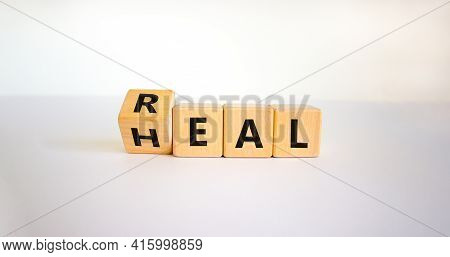 Real Heal Symbol. Turned Cubes With Words 'real Heal'. Beautiful White Background, Copy Space. Medic