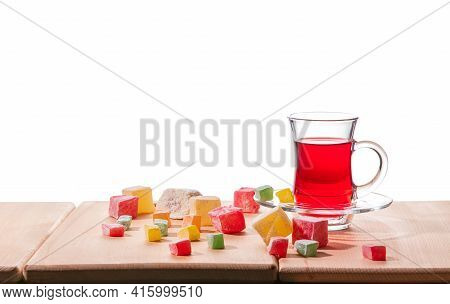 Traditional Turkish Delight, Lokum, And Turkish Tea On The Wooden Table, Isolated On A White Backgro