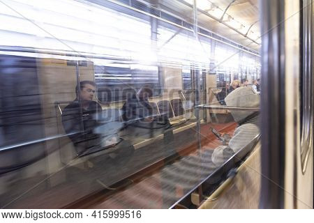 Moscow. Russia. Autumn 2019. People Ride In A Subway Car. Reflection In A Subway Car.