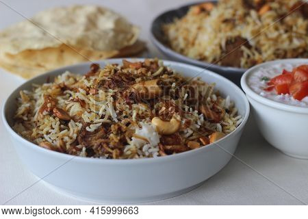 Mutton Biryani. A Dish Cooked With Spices Layered Between Mildly Spiced Ghee Rice With A Generous Sp